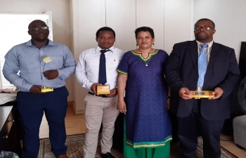 Education Ministry officers learn to assemble solar lamps being gifted by India to Eswatini